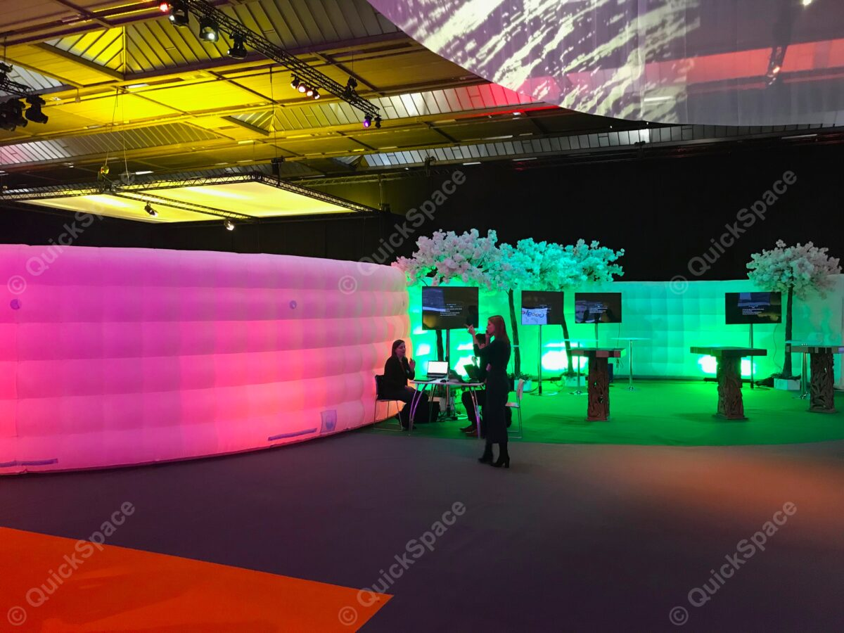 Inflatable curved walls